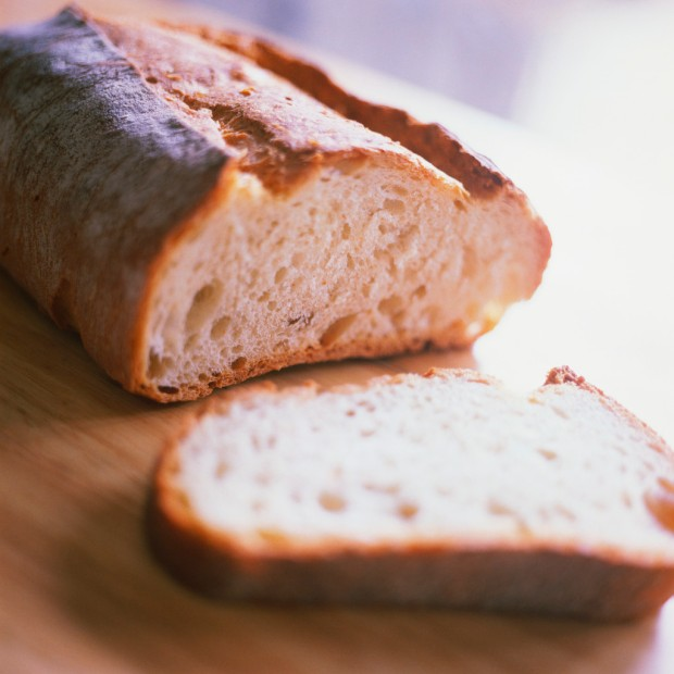 """An innocent virgin loaf of bread...just ripe for mastication or destruction via vampire grocery store worker in name tag, featuring orange stick on the back with """"booth bitch"""" engraved there upon.  Photo credit:  to clipart bitches!!"""