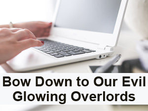 Bow down to our evil glowing overlords. Photo of hands on a laptop