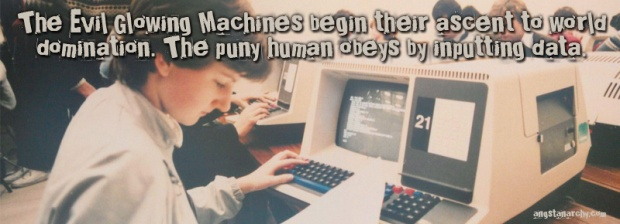 The Evil Glowing Machines begin their ascent to world domination. The puny human obeys by inputting data. Photo: 1980's computer